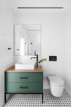 bathroom cabinets The focal point is the beautiful green vanity. My eyes then travel to the sink. I love how the sink and the toilet both are rounded, where everything else is more rectilinear. Bathroom Vanity, Bathroom Interior, Bathroom Decor, Tile Bathroom, Bathroom Furniture, Bathroom Interior Design, Green Vanity, Green Bathroom, Bathroom Design