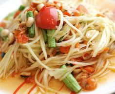"""Thai papaya salad, also called """"som tum"""" is a fun and spicy side dish. Although in Thai cuisine, papaya salad is usually made with fish sauce and shrimp, this vegetarian som tum recipe is just as good (if not better!)."""