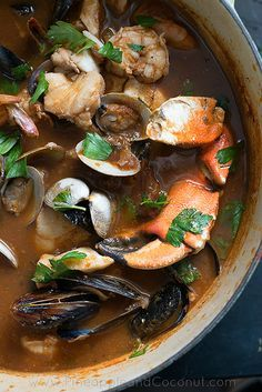 Spicy Cioppino (garlic, butter, olive oil, fennel, leeks, white onion, dried basil, dried oregano, smoked paprika, red chile flakes, balsamic vinegar, white wine, red wine, tomato paste, clam juice/seafood stock, tomatoes, bay leaves, sea salt, black pepper, manilla clams, mussels, prawns, cod/firm white fish, rock crab claws/scallops/calamari/dungeness crab/snow crab/little neck clams/cockles, parsley, Tobasco/habanero hot sauce)