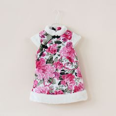 Warm for winter.  Beautiful flower printing. Kids Cheongsam. Chinese know button shows charm of cheongsam.  Zip at back make it easy to wear