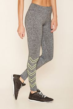 A pair of marled stretch-knit leggings with a back zipper pocket, chevron print on the sides, and moisture management.