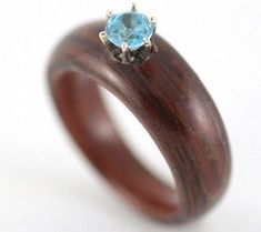 Rosewood and blue topaz wooden engagement ring - made with reuse wood.