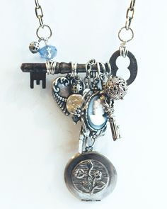 "Buffalo, NY Necklace - ""Charmed"" with skeleton key and repurposed costume jewelry charms, locket, cameo. $47.16, via Etsy."