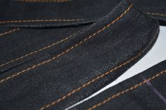 Close up of the #selvedge handloom denim strips with face of the fabric visible. #Swadeshi  Exclusive Hand-stitched Cushion Cover in the making..... This cushion cover is made from eco-friendly handloom denim, and is completely hand-stitched on a foot pedal operated vintage sewing machine, by a seasoned tailor.  The chess-board design, made by interlacing strips of denim fabric, is an ever-green design, and has a mesmerizing effect.  The darker color is the face of the fabric, and the ligh