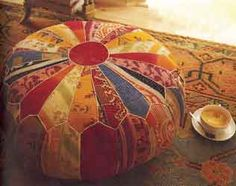 Vintage patchwork pouffe! This would be an excellent thing to have for me especially, as a disproportionate number of people I know like to sit on the floor.