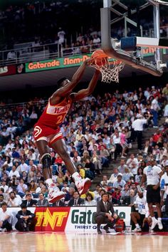 Dominique Wilkins of the Atlanta Hawks throws down a two-handed dunk with power during the 1990 Gatorade Slam Dunk Contest played at the Miami Arena on Feb. Basketball Legends, College Basketball, Basketball Players, Basketball Hoop, Basketball Jones, Basketball Diaries, Basketball History, Basketball Uniforms, Slam Dunk