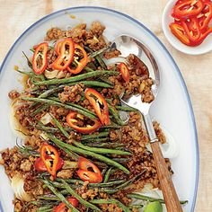Pork-and-Green Bean Stir-Fry | The key to this dish is developing a nice char on the green beans. To do so, heat the oil in your skillet until it almost smokes before adding the beans. Let them sear, stirring every 20 to 30 seconds, and they'll take on color.