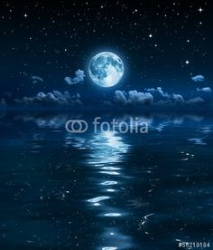 Photo: super moon and clouds in the night on sea