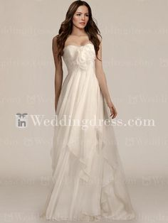 Elegant summer wedding dress features in Chiffon. Strapless gown features a pleated empire bodice that is accented with a detachable flower and feather pin. The beautiful flowing skirt is created from multiple layers of bias-cut chiffon. Hidden back zipper with hook and eye closure, fully lined in satin. $239