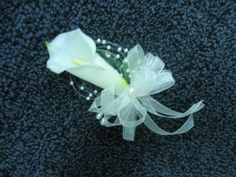 Wedding Corsages Calla Lilly... What about something like this only using the orange Calla Lilly, maybe with navy ribbon??? I do like the pearls