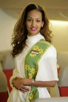 Ethiopian Airlines flight attendant in Ethiopian Dress Ethiopian Beauty, Ethiopian Dress, Habesha Kemis, Eritrean, Ethiopian Traditional Dress, African Traditional Dresses, Airline Attendant, Flight Attendant, Airline Uniforms
