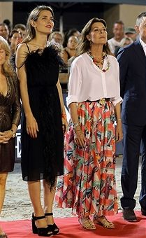Charlotte Casiraghi (L) and Princess Caroline of Hanover (c) attend a ceremony during the 2017 edition of the Jumping International of Monaco horse jumping competition as part of the Global Champions Tour on June 24, 2017 in Monaco. /