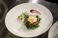 Courtney's Appetizer: Crispy pig's ear with a dandelion and fennel salad, served with a quail egg and chili sauce.