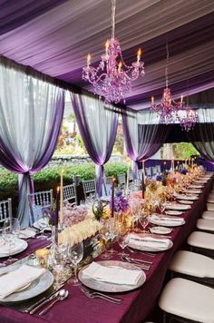 Love these purple crystal chandeliers above the silver, plum, and lavender tablescape