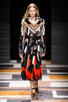 Xoxo The quickest way to a coat of many colors is cool patchwork—done up in layered neutral hues or with a hit of red for graphic impact. Pictured: Salvatore Ferragamo   - HarpersBAZAAR.com  Follow me @glamazonFINE  VISIT www.blondeglamazon.com
