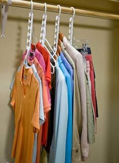 Maximize your closet storage by using wonder hangers.