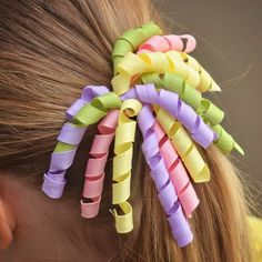 Learn how to make your own curly ribbon hair bows for your little girl. It's easier than you think!