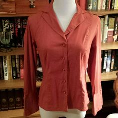 "Petite Fitted Rust Blouse Decorative buttons, bell sleeves, beautiful color. EXCELLENT used condition. Size tag has been removed for comfort. Flat chest: 17""; shoulder: 14""; outer sleeve: 22""; neck to hem: 24"". Not sure of the material content but there is definitely spandex. Apostrophe Tops Blouses"