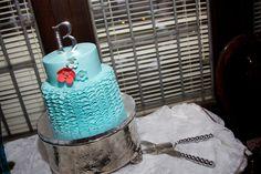 Beautiful turquoise and poppy ruffle wedding cake