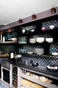 Subtle purples and rustic materials in Paris // Kitchens // plates, bowls, counters