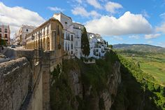 Living on the edge in Puente Nuevo, Ronda, Spain Ronda Spain, Land Of Oz, Living On The Edge, History Books, Cliff, Beautiful Places, Castle, Mansions, Architecture