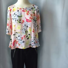 """Pink Floral Wide Sleeve Blouse XUC: approx 22"""" long; relaxed bust approx 32"""";  multi-color flower print on pink background; button eyelet closure on back Liz Claiborne Tops Blouses"""