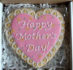 Happy Mother's Day heart decorated cut-out sugar cookie.