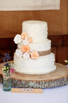 Icing Flowers Hessian Log Cake Quaint Rustic Seaside Windmill Wedding Norfolk http://www.fullerphotographyweddings.co.uk/