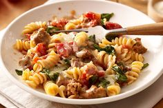 Italian sausage as part of a smart eating plan? You bet. Pasta, tomatoes, fresh spinach plus melty cheese presents old-world flavor in a new-world dish.