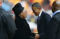 President Barack Obama pays his respect to former South African President Nelson Mandela's widow Graca Machel