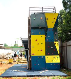 Measuring 8 ft wide x 16 ft high, this climbing wall was designed and built for FunScapes, an amusement part in Nairobi, Kenya. We built this climbing wall against a vertically stacked shipping container. It also has two bouldering walls on adjacent sides of the shipping container.  #FeetOffGround #ClimbingWall #BoulderingWall #RockClimbing #ShippingContainer #ShippingContainerConstructions #RepurposedShippingContainer Climbing Wall, Rock Climbing, Children's Playground Equipment, Bouldering Wall, Outdoor Fitness Equipment, Ropes Course, Outdoor Workouts, Nairobi, Kenya
