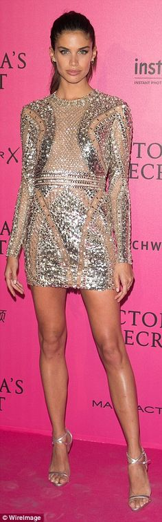All that glitters: Sara swapped her underwear for a glittery silver dress and spiky heels at the Victoria's Secret Fashion Show' after show photocall