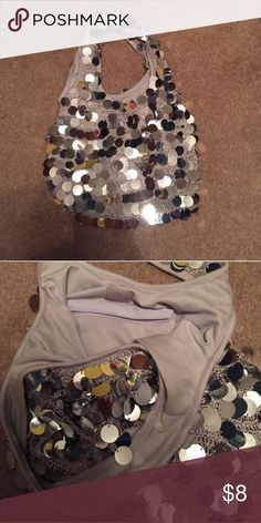 Gray Sparkly Purse Pre-Owned but no signs of use! Inside is in great condition as well as outside! No stains, tears or rips! Bags