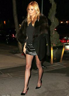 If you've got it: Heidi Klum dressed to impress as she flashed her supermodel legs from un...