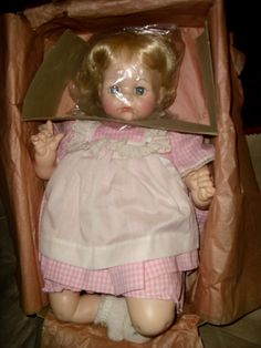 """Madame Alexander Pussycat baby doll. Got her for Christmas one year. When you tipped her over she said """"Mama."""" She is long gone now, but I remember loving her."""
