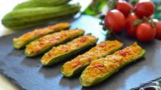 Découvrez ces délicieuses courgettes farcies à la ricotta et aux tomates cerises, un plat rapide et léger car les courgettes sont cuites au four et farcies