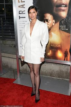 Unique: Roselyn Sanchez opted to go pants-less for the festivities, sporting a long white . mod vibes w puffy sleeves) Celebrity Travel, Celebrity Style, Roslyn Sanchez, Paula Patton, New Boyfriend, Jessica Biel, Old Actress, Nice Legs, Red Carpet Looks