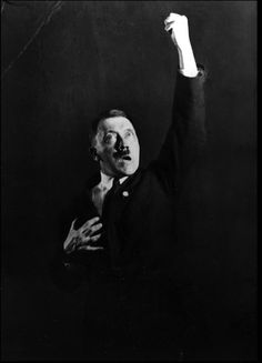 Weird private photographs of Hitler practicing dramatic gestures for his speeches