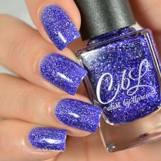 Colors by llarowe August 2016 PotM - A Galaxy Far, Far Away - purple jelly base with shimmering holo flakes. Depending upon the light this polish looks purple, blurple and sometimes even blue. This polish glows in sun and shade with a gorgeous scattered holo effect. Swatch by @delishiousnails.