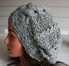 A beautiful cabled slouchy hat or tam hand by TrinksKnitting