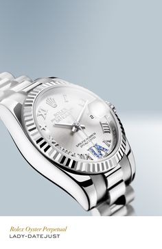 Rolex Lady Datejust 26 mm in 18 ct white gold with a fluted bezel, silver dial and President bracelet. #RolexOfficial