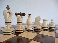 This model has very original handmade pieces with copper incrustation. The large chessboard is made of beech and birch wood.  The quality is assured