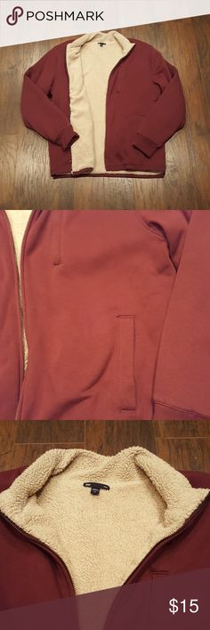Gap Zip-UP Very warm Jacket.. very snuggly feeling. Color is like a maroon brown mix.. almost looks vintage. Very different color from the gap line. Like a maroon rust.. idk.  Nevertheless it is warm and blocks the wind..EUC 3 pockets.. I would give it a 8.9/10 condition.. size XL in mens... very athletic style of zip up.. not really a date night zip up... Gap Sweaters Zip Up