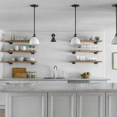 Industrial Wood and Iron Shelves Flanking Sink