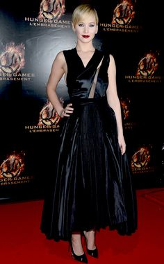 Jennifer Lawrence goes gothic glam in in a black pleated silk Haute Couture dress by Dior at the 2014 Catching Fire's Paris premiere. #fashion