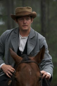 Norman Reedus looks good in hats.