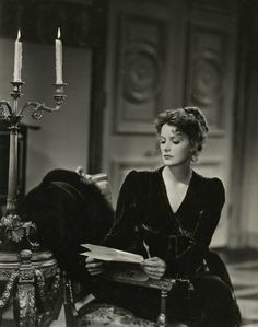 Greta Garbo, as Countess Marie Walewska, reads in Conquest, 1937. Photograph by Clarence Sinclair Bull.  Books and Art