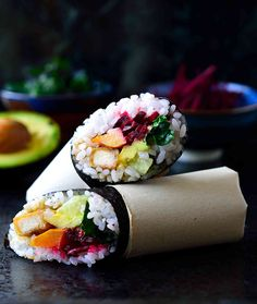 This vegan sushi burrito recipe is easy and delicious stuffed with a rainbow of vegetables and deliciously crispy fried teriyaki tofu.