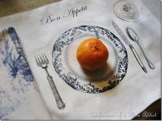 A DIY French Inspired Table setting: Free graphic for iron-on transfer~ Iron on individual place settings onto a large  linen tablecloth.