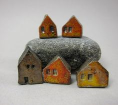 Saggar fired miniature house beads. I'd like to make a little set of tiny buildings with Fimo clay for a bookshelf